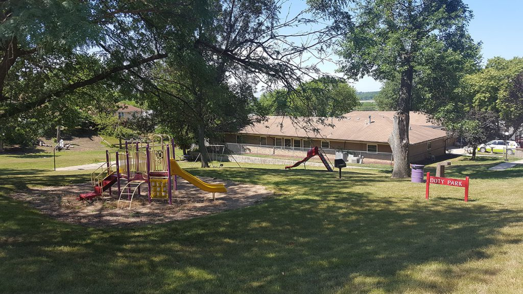 Doty Park is a pleasant, little park nestled in a quiet neighborhood that sits on a quarter-acre of land at 1017 5th Avenue North. It features playground equipment, slide, swing set and a half-size basketball court.